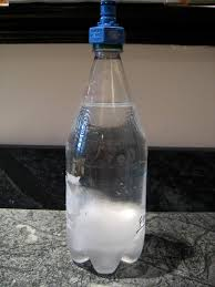 a bottle after ing on the carbonator the same bottle after expelling the air
