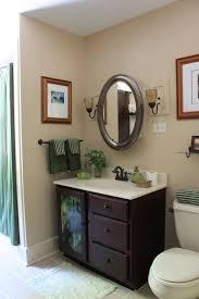 bathroom ideas for decorating. Home Decor, Traditional Bathroom Design Iron Oval Mirror Marmer Wastafel Dark Chocolate Wardrobe Ceramic Floor Ideas For Decorating I
