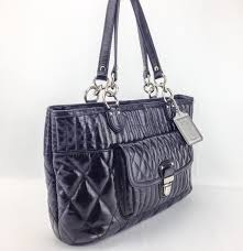 ... coach leather tote quilted push lock shoulder bag .