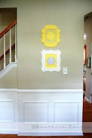 diy fake wainscoting chair rail along the wall glue trim squares underneath paint the whole panel