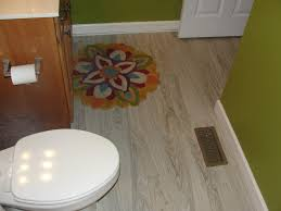 interesting bathroom tile with allure flooring and baseboard and bathroom vanity cabinet