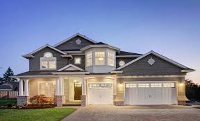grey color house with white trim and double car garage doors