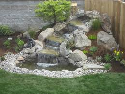 Lawn & Garden:Awesome Three Level Stone Waterfall In Backyard Design With  Wooden Fence And