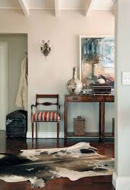 american colonial homes brandon inge: cow hide actually looking good like the chair