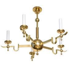 scandinavian modern chandelier five arm polished brass banded center sphere for