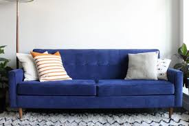 a blue suede couch in a living room