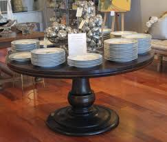image of 60 inch round ash pedestal table which can be made with leaves