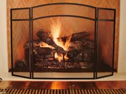 a classical and elegant copper fireplace screen