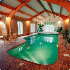 Beautiful Indoor Swimming Pool Area With Sitting Space