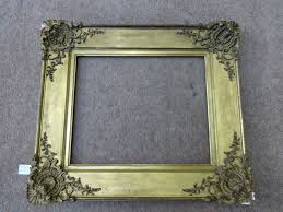 an ornate gilt 19th century frame ref 537