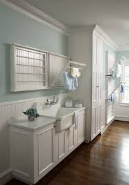 clothes hanger rack laundry room traditional with clothes rack drying racks farmhouse sink light blue wall bright modern laundry room