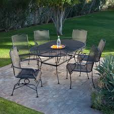 black iron outdoor furniture. Black Wrought Iron Patio Furniture With Curved Table And Brick Motif Pattern Tiles Outdoor W