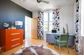 orange home office. chalkboard wall in the home office with a bold orange cabinet from kailey j i