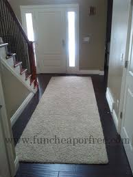 that s another huge rug worth of carpet we had her cut it in half and made two 4 12 runners we put one by our front door