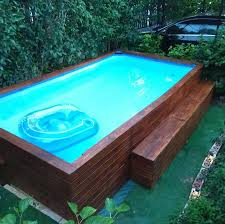 Above ground swimming pool Modern Aboveground Pool The Spruce Aboveground Swimming Pools Designs Shapes And Sizes