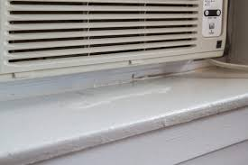 window air conditioner inside. besides the main drainage hole that allows water to drip outside, many air conditioners also have a series of small channels direct from front window conditioner inside