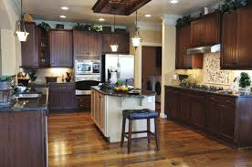 dark kitchen cabinets with light wood floors light floors dark cabinets nurani