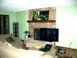 fireplace with tv over over fireplace hang over fireplace mounting over fireplace full size of living fireplace with tv over