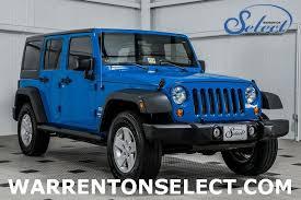 2011 jeep wrangler unlimited 4 door sport 16129645 0