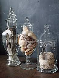 Fill apothecary jars with feathers, shells, rope, rocks, etc for a year