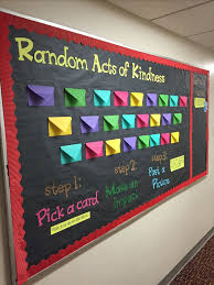 random acts of kindness board full of rak ideas as well as section titled lend a hand where residents can earn a hand meaning they did a random act of bulletin boards
