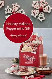send a unique gift with this festive mailbox filled with sweet holiday treats this north pole delivery includes bakery fresh dark chocolate