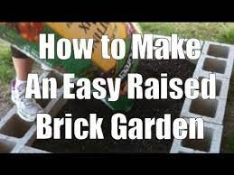 a raised garden bed from bricks