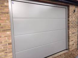 garador linear large premium sectional garage door in stone grey with a matching steel frame