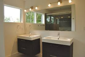 double ikea floating bathroom vanity sink unit with large mirror and wall lights