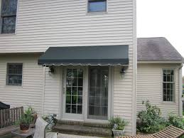 canvas awning installed over a sliding glass door