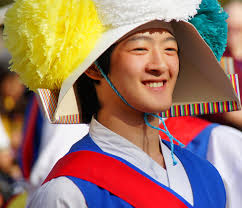 guest post nomadic samuel photo essay of south korea  adventure  a smiling korean performer delights the onlooking crowd with his spectacular acrobatics in a traditional performance