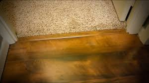how to install transition over carpet and hardwood on concrete floor