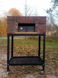 picture of outdoor propane wood fired oven in red brick