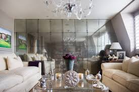 Another way to decorate the living room wall is to decorate the entire wall  with mirrors or rather design it with a mirrored tile.