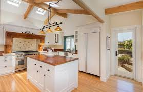 white country style kitchen cabinets and hardwood top island