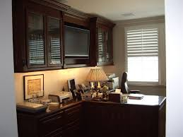 custom home office design for a stock broker with a built in tv built desk small home office