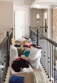 overstuffed linen closet before organization