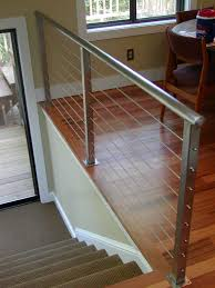 decks with wire cable railings   railing is a deco steel guardrail tubing  aircraft cable railing