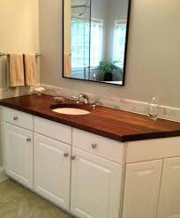 a wooden finished with dark brown stain in kitchen white cabinets wood countertops