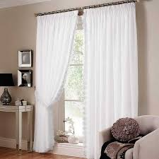 image of white curtains sliding glass door