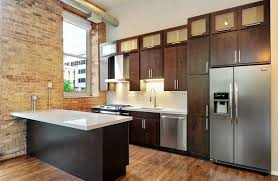 contemporary kitchen with dark brown cabinets white quartz counters and exposed brick walls