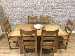 1 4m 6 seat extending round edged oak dining table