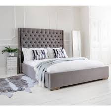studs ons grey upholstered bed