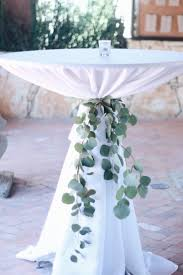 Eucalyptus cocktail table ties are such a lovely element to add! | Whim  Florals  Round Table CenterpiecesGreenery ...