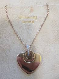 bvlgari cuore collection heart pendant with chain in 18 kt rose gold with pavé