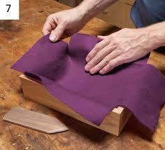 place a piece of felt inside the box push down on the felt with a rounded wood stick to smooth it out then apply glue to the sides and smooth out each