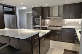 modern dark cabinet and white counter kitchen with porcelain tile floors