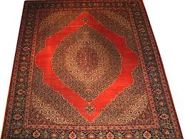 name tabriz haji jalili dimension 9ft 2in by 12ft 10in from northwest of persia age 1900 color rust indigo