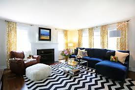 yellow curtain and navy blue sectional sofa for amazing living room ideas with black and white rug