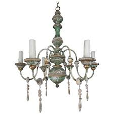 italian painted and parcel gilt chandelier with wood drops